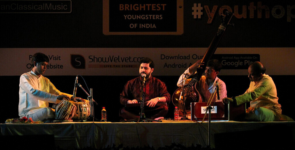 photo of the concert, on stage Samrat Pandit, tabla, harmonium and vocal support tanpura