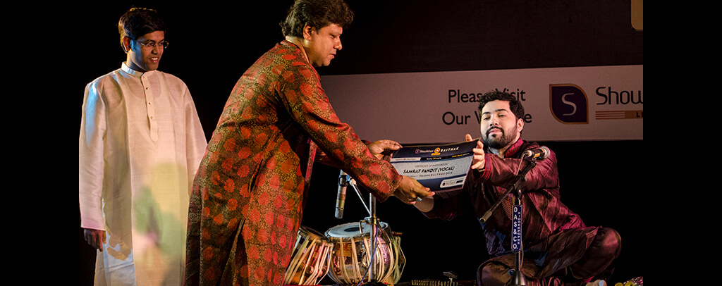 photo of Subankar Banerjee, famous tabla player awarding Samrat Pandit