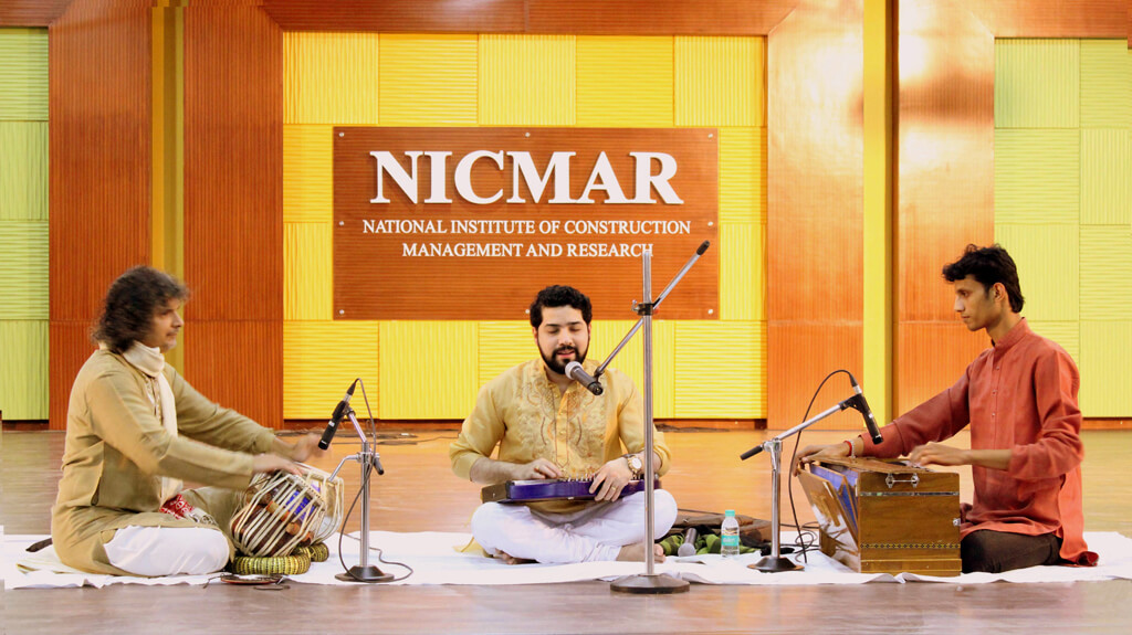 Photo of the concert with tabla and harmonium